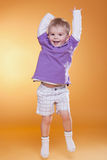 Happy Jumping Cute Boy In Violet T-shirt Stock Photo