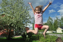 Happy jumping girl. Happy jumping girl on a blue sky background Royalty Free Stock Photography