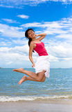 Happy jumping girl Stock Photo