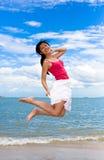 Happy jumping girl stock photo