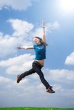 The happy jumping girl. On a background of the blue sky Stock Image