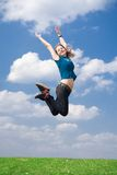 The happy jumping girl. On a background of the blue sky Royalty Free Stock Photography