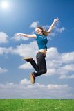 The happy jumping girl Stock Photography