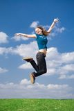 The happy jumping girl. On a background of the blue sky Stock Images