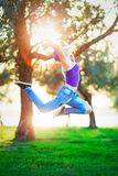 Happy jumping girl in sunny day royalty free stock photography