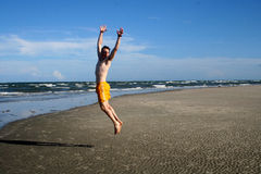 Happy jumping man. Happy man jumping on beach Stock Photography