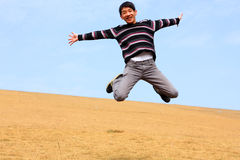 Happy jumping man Royalty Free Stock Photography
