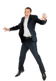 Happy jumping man. Happy jumping young businessman isolated on white background Royalty Free Stock Images