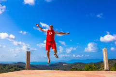 Happy jumping man on the mountain Stock Photo