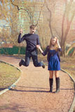 Happy jumping pair Royalty Free Stock Images