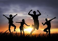 Happy Jumping People. Active young people jumping against a sunset Royalty Free Stock Image