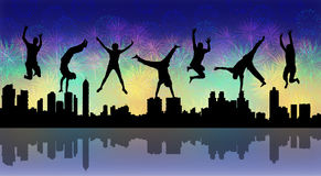 Happy jumping people with a night firework. Silhouettes of young happy people jumping a firework above a big city panoramic silhouette Royalty Free Stock Photo