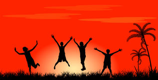 Happy jumping people. Silhouette of happy people jumping at sunset Stock Photography