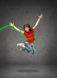 Happy jumping teenage girl stock image