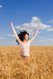happy jumping wheat woman Стоковые Фото