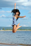 The happy jumping woman. The happy young jumping woman Royalty Free Stock Photos