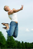 Happy jumping woman. Stock Photo