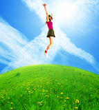 Happy jumping woman Stock Images