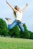 Happy jumping woman. Stock Photos