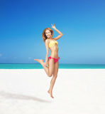 Happy jumping woman on the beach. Bright picture of happy jumping woman on the beach Stock Photo