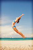 Happy jumping woman on the beach. Bright picture of happy jumping woman on the beach Royalty Free Stock Photo