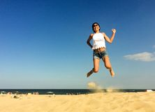 Happy jumping woman Stock Photos