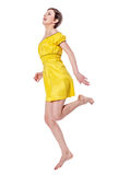 Happy Jumping woman. Young cheerful brunette woman jumping isolated on white Royalty Free Stock Photos