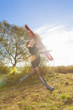 Happy Jumping Young Blond Woman Royalty Free Stock Photography
