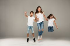 Happy jumping young friends stock image