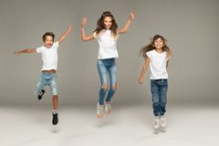 Happy jumping young friends royalty free stock photo