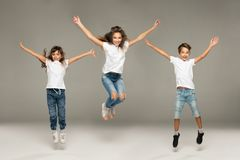 Happy jumping young friends royalty free stock images