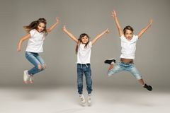 Happy jumping young friends stock photography