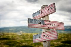 Free Happy Juneteenth Day Text On Wooden American Flag Signpost Outdoors Royalty Free Stock Images - 182479069
