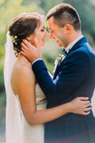 Happy just married couple holding each other outdoor at sunny day Stock Image