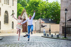 Happy just married couple jumping Stock Images