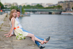 Happy just married couple on the Seine embankment Stock Photos