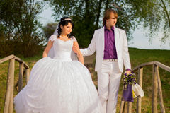 Happy just married couple standing on the small Stock Photography