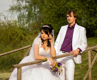 Happy just married couple standing on the small Stock Images