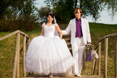Happy just married couple standing on the small Royalty Free Stock Photo