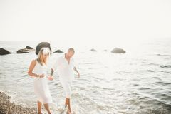Happy just married young wedding couple celebrating and have fun at beautiful beach sunset. Happy just married young couple celebrating and have fun at beautiful Royalty Free Stock Image