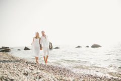 Happy just married young wedding couple celebrating and have fun at beautiful beach sunset Royalty Free Stock Image
