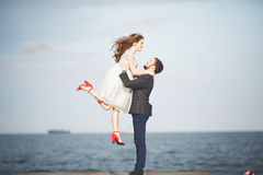 Happy just married young wedding couple celebrating and have fun at beautiful beach sunset. Happy just married young couple celebrating and have fun at beautiful Stock Image