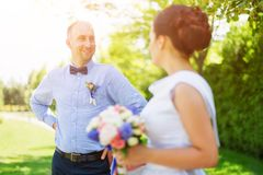 Happy just married young wedding couple having fun in the park. Bride and groom together, love and marriage theme. Happy just married young wedding couple Stock Photography