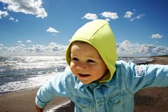 Happy kid. Kid at sea Stock Images