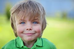 Happy kid. Against green natural background royalty free stock images