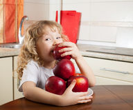 Happy kid with apple Royalty Free Stock Image