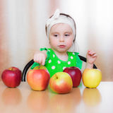 Happy Kid with apples. Stock Images