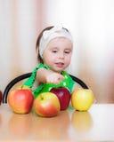 Happy Kid with apples. Stock Photos
