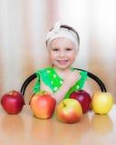 Happy Kid with apples. Stock Photo