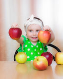 Happy Kid with apples. Royalty Free Stock Image
